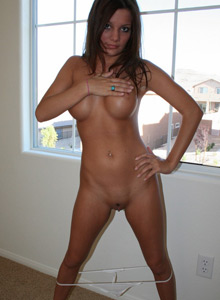 Katie Strips Naked Infront Of A Window For The Neighbors To Watch - Picture 12